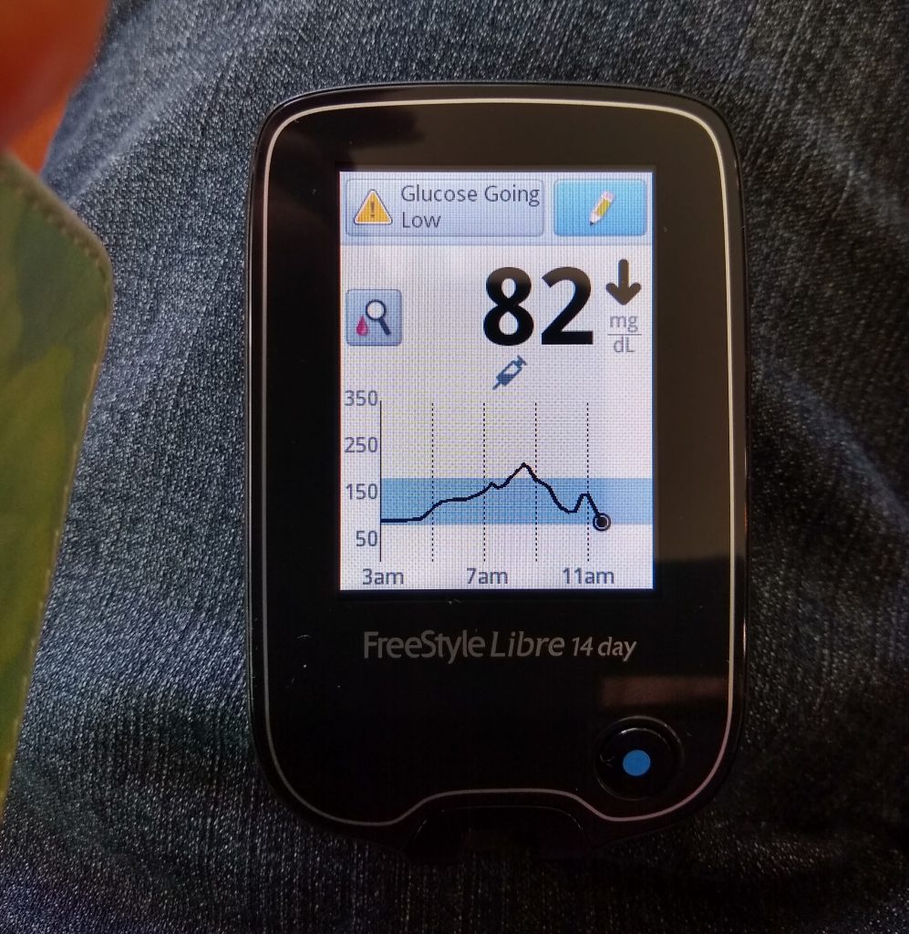 Freestyle Libre 14 Day System Reader showing graph and glucose trend