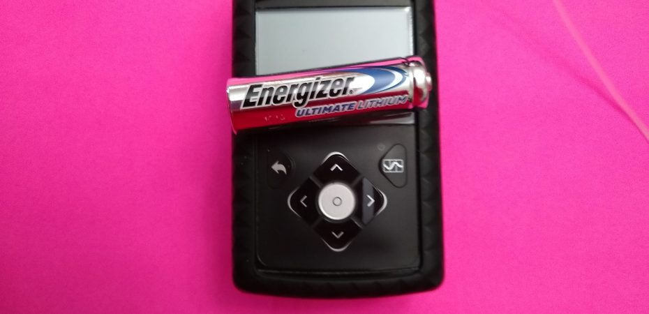 energizer lithium battery in front of medtronic 670g insulin pump