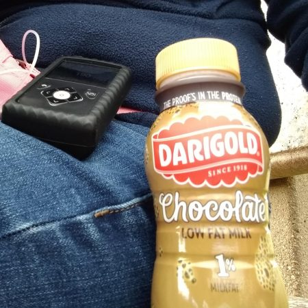 Sitting on the bench with chocolate milk